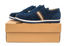 Pair of blue leisure shoes for man on a box on white Royalty Free Stock Photography