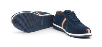 Pair of blue leisure shoes for man on white Stock Photography