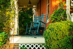 Pair of blue rocking chairs Stock Images