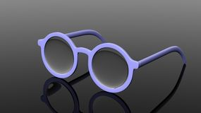 Pair of blue round-lens eyeglasses Royalty Free Stock Photo