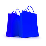 Pair of blue shopping bags. 3D rendering of two blue shopping bags against a white background Royalty Free Stock Photo