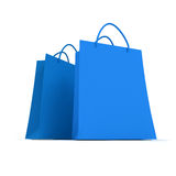 Pair of blue shopping bags. 3D rendering of two blue shopping bags against a white background Royalty Free Stock Photos
