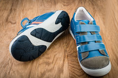 Pair of blue sneakers in children size Stock Image