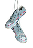 Pair of blue sneakers hangs on the laces. Royalty Free Stock Photo