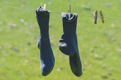 Pair Of Blue Socks Hanging royalty free stock photos