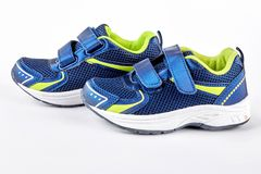 Pair of blue sport trainers. Sport shoes isolated on white background. New running sneakers on sale Stock Images