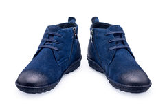 A pair of blue sports shoes with shoelace Royalty Free Stock Photo