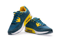 A pair of blue sports shoes with shoelace Stock Photo