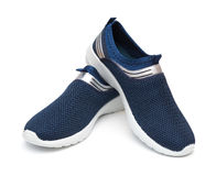Pair of blue sporty shoes for man. On white background stock photography