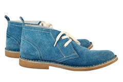 A pair of blue  suede  shoes with white  laces isolated on a whi Royalty Free Stock Image
