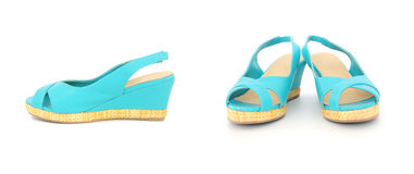 Pair of blue summer lady shoes. A pair of blue summer lady shoes on white - front and side view Stock Photo