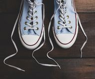 Pair of blue textile sneakers royalty free stock photo