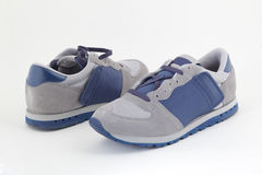 Pair of blue trainers. On a white background Royalty Free Stock Photo