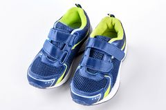 Pair of blue trainers on white background. Stock Images