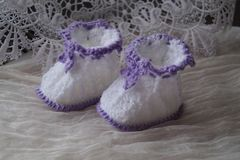 Pair of  bootees for newborn Stock Images