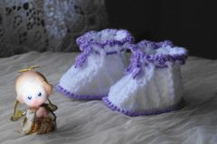 Pair of  bootees for newborn Stock Photo