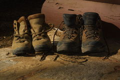 Pair of Boots. Boots in front of cabin stock photo