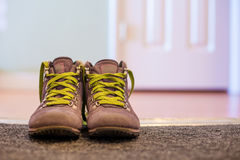 A pair of boots. A pair of children boots in a doorway Royalty Free Stock Photo