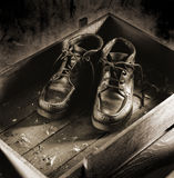 Pair of  boots in a box. Pair of old boots in a box of wood Stock Photography