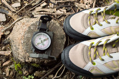 Pair of boots with compass in autumn in the forest Stock Image