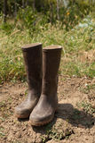 Pair of boots in garden. Pair of dirty muddy boots in garden stock photography