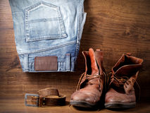 A pair of boots, jeans and leather belt Royalty Free Stock Photo