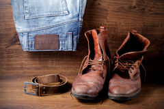 A pair of boots, jeans and leather belt Royalty Free Stock Photos