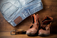 A pair of boots, jeans and leather belt Stock Image