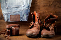 A pair of boots, jeans and old camera Royalty Free Stock Image