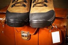 Pair of boots with suitcase Stock Photo