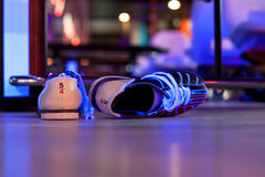 Pair of bowling shoes. Laying on the floor royalty free stock photography