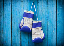 Pair of boxing gloves hanging on a nail Stock Photo