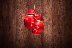 Pair of boxing gloves hanging on a wall Royalty Free Stock Photo