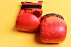 Pair of boxing gloves lying next to each other. stock photos