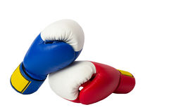 A pair of boxing gloves on white. Boxing gloves lie on each other on a white background Royalty Free Stock Photos