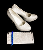 Pair of bride shoes and wedding invitation Royalty Free Stock Photos