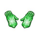 Pair of bright green winter knitted mittens with snowflakes Royalty Free Stock Photography