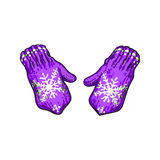 Pair of bright purple winter knitted mittens with snowflakes Stock Image