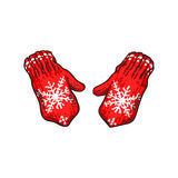 Pair of bright red winter knitted mittens with snowflakes Royalty Free Stock Images