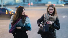 Pair of briunette gorgeus pretty girls walking across the streeet, laughing and talking, Steady cam, slow mo shot stock footage