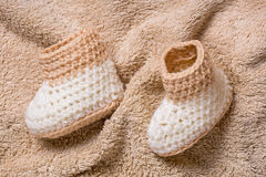 Pair of brown baby booties Royalty Free Stock Images