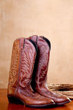 A pair of brown cowboy boots rope Royalty Free Stock Image