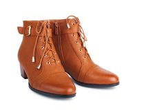 Pair of brown female boots Royalty Free Stock Photo