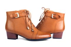 Pair of brown female boots isolated Royalty Free Stock Photos