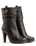 Pair of brown female boots on white Royalty Free Stock Image