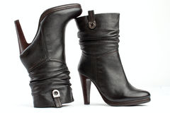 Pair of brown female boots on white Stock Photo