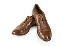 Pair of brown leather men shoes isolated on white. Royalty Free Stock Images