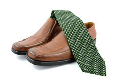 Pair of brown male business shoes and green tie Stock Photography