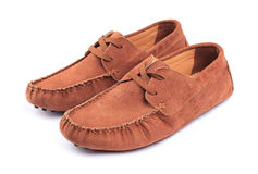 Pair of brown male moccasins. Over white background Royalty Free Stock Photos