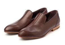 Pair of brown male shoes. Over white background royalty free stock photography